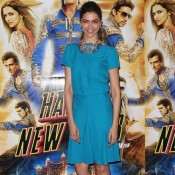 Deepika Padukone at London looking cool in Plain Blue Knee Length Fancy Skirt during Happy New Year Promotion