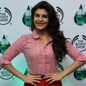 Jacqueline Fernandez in Red Short Skirt Launching Beauty Product in Kolkata