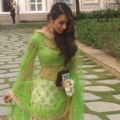 Malaika Arora Khan in Off White Green Lehenga Choli at Arpita's Wedding Place in Falaknuma Palace Hyderabad