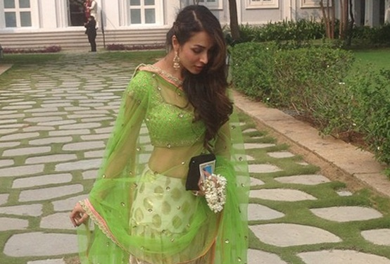 Malaika Arora Khan in Off White Green Lehenga Choli at Arpita's Wedding Place in Falaknuma Palace Hyderabad