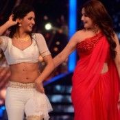 Madhuri Dixit in One Shoulder Blouse Pics – Red Blouse Photos On The Sets of Jhalak Dikhhla Jaa 7