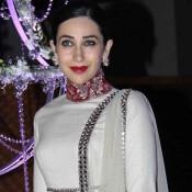 Karisma Kapoor in White Red High Neckline Suit at Riddhi Malhotra Sangeet Ceremony