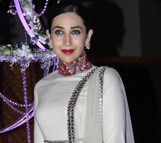 Karisma Kapoor In White Red High Neckline Suit At Riddhi