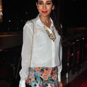 Karishma Kapoor in Floral Jeans and White Shirt at Charity Art Auction 2014