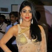 Shriya Saran in White Transparent Saree Pics at Manam Movie Premiere Show