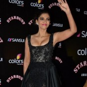 Sonam Kapoor in Front Open Black Evening Gown at Stardust Award 2014
