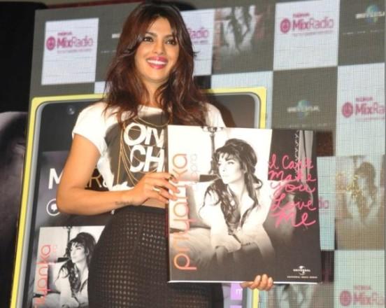 Priyanka Chopra in Black Transparent Knee Length Skirt Pics at Launch of Album I Can't Make You Love Me in Mumbai