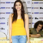 Alia Bhatt Cute Smile Pics and Attractive Face Expression in Yellow Skin Tight T-Shirt and Blue Jeans