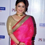 Bollywood Actress Divya Dutta in Wide Open Neck Blouse of Shining Golden Colour Paired with Designer Pink Saree at 15th MAMI Film Festival in Mumbai