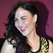 Elli Avram Cute Smile Pics with Attractive Face Expression Photos in Yellow Black Short Dress