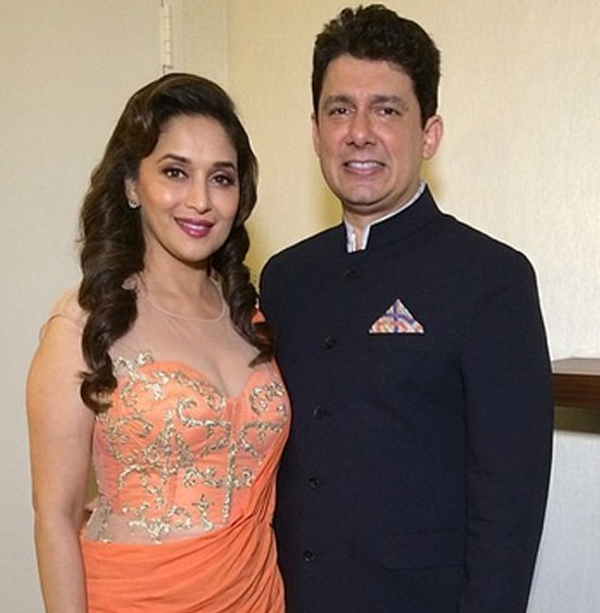 Madhuri Dixit Hot Cleavage Show Pics in See Through Orange Evening Dress at IIFA 2014 Awards USA