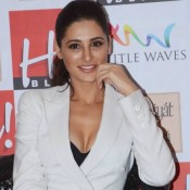 Nargis Fakhri Cleavage Pics in White Blazer and Printed Jeans