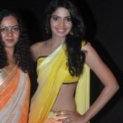 Pooja Sawant Hot Navel Show Pics Sexy Photos in Yellow Orange Saree