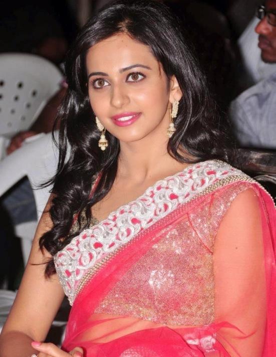Rakul Preet Singh in Red Transparent Saree Pics – Hot Navel Show Photos