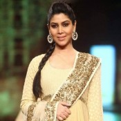 Sakshi Tanwar in Cream Anarkali Dress Suits with Heavy Earrings at Caring with Style` 9th Annual Fashion Show