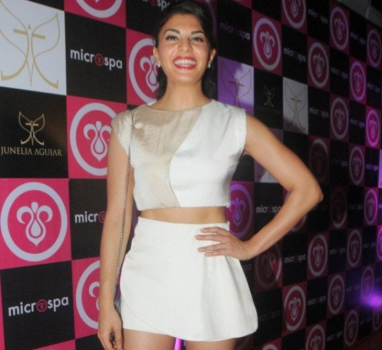 Jacqueline Fernandez Hot Legs Photos in White Short Mini Skirt