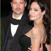 Cool Tattoos on Cute Arms and Hot Body of Angelina Jolie wearing Strapless Cleavage Exposing Black Dress Evening Gown