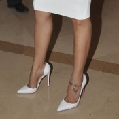Guess The Bollywood Actress Name showing Hot Feet Sexy Legs in High Heel Sandals with Short Knee Length Dress ?