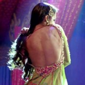 Guess The Name of Actress showing Bare Back in Hot Backless Anarkali Dress ?
