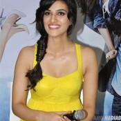 Kriti Sanon Hot in Yellow Dress Sexy Legs Pics at Music Launch of Movie Heropanti in Mumbai
