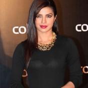 Priyanka Chopra in Tight Black Skirt at Colors Party – Hot Thigh Show Bold Images