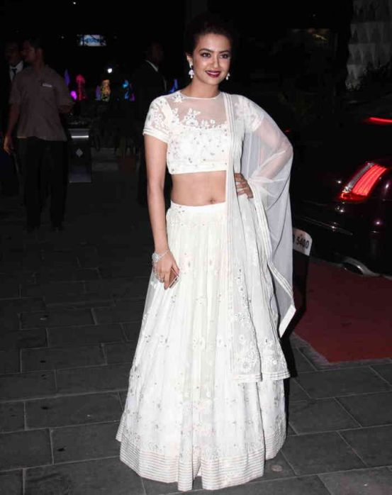 Surveen chawla in white lehenga at tulsi kumar hitesh for Dress after wedding ceremony