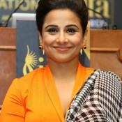 Vidya Balan in Orange Cleavage Exposing Dress during IIFA Awards 2014 Press Conference at New York in USA