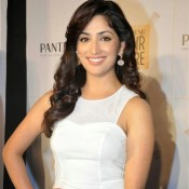 Yaami Gautam Hot in White Short Dress Sexy Legs Exposing at Launch Pantene