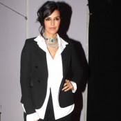 Neha Dhupia in Black Suit at India Fashion Forum 2015