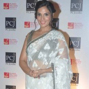 Richa Chadda Hot Navel Images in White Transparent Saree at 5th Annual Mijwan Fashion Show 2015
