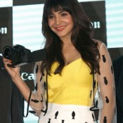 Anushka Sharma in White Skirt at Canon Wifi Cameras Launch Hot Photos