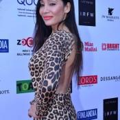 Sofia Hayat in Leopard Print Backless Jumpsuit Dress – Hot Photos Animal Print One Piece at India Resortwear Fashion Week 2013