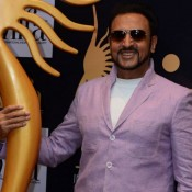 Gulshan Grover in White High Neck T-Shirt with Dark Jeans Goggles Cool Look at IIFA 2015 Press Meet