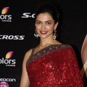 Deepika Padukone in Red Golden Saree Sleeveless Blouse Photos at IIFA 2015
