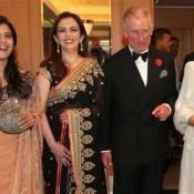Kajol in Sleeveless Blouse Transparent Pink Saree With Royal Couple Prince Charles And Camilla