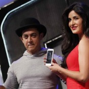 Katrina Kaif Hot Legs Pics in Red Short Dress at DHOOM 3 Promotion
