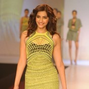 Sonam Kapoor in Sleeveless Green Gown Dress at Signature International Fashion Weekend