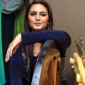 Huma Qureshi Hot Pics in Sleeve Blue Shirt at Launches New Pipal Tree Hotel Kolkata