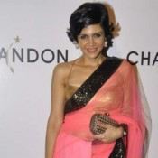 Mandira Bedi in Pink Transparent Saree Sleeveless Blouse