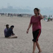 Shilpa Shetty Hot Legs Pics in Pink T Shirts at Juhu Beach