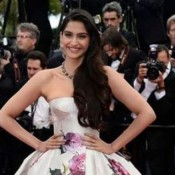 Sonam Kapoor Cannes Film Festival 2013 Photos in Dolce and Gabbana White Floral Dress
