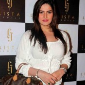 Zarine Khan Hot Pics in White Top at Lista Jewels Store Launch Mumbai