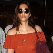 Sonam Kapoor in Red Brown off Shoulder Gown at Mumbai Airport after Shooting Song in Turkey