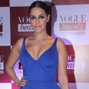 Neha Dhupia Hot in Blue Plugging Neckline Gown at Vogue Beauty Awards 2015 Photos