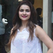 Prachi Desai in White Skirt with Crop Transparent Top at Vogue Bridal Studio 2015