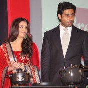 Aishwarya Rai in Red Dress – Traditional Red Velvet Dress Photos at Prestige Cooker Ad