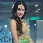 Karishma Kapoor in Green Anarkali Dress at Walks the Ramp for Monarch Universal