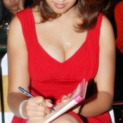Richa Gangopadhyay Hot Cleavage Expose Pics Milky Legs Show in Short Red Dress