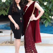 Zarine Khan in Red Saree with Sleeveless Backless Maroon Velvet Blouse Pics