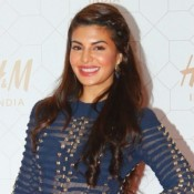 H&M Launch In India Photos 2015 – Jacqueline Fernandez in Red Mini Skirt Shorts Photos